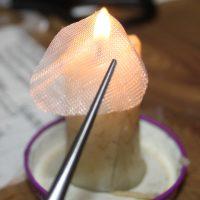 Держим над свечой